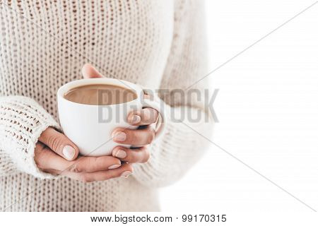 Warming Cup Of Coffee In The Hands Of Women Isolated