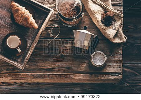 Coffee Preparation On Old Wooden Table In Evening Window Light