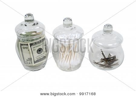 Apothecary Jars Filled With Money, Cleaners And Hair Clips