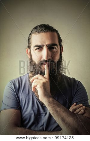 Long-bearded man thinking of something