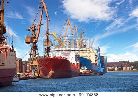 Industrial View With Ships And Cranes