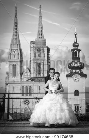 Bride And Groom In Front Of Cathedral Bw