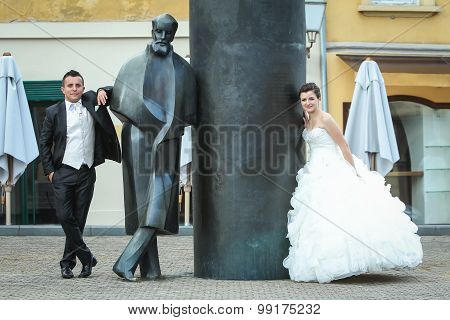 Newlyweds Leaning On August Senoa Monument