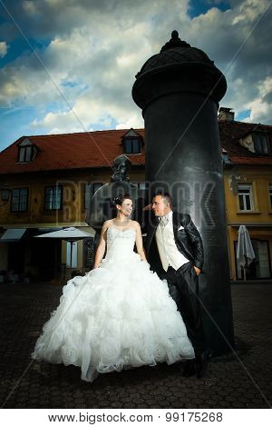Newlyweds Posing In Front Of August Senoa Monument