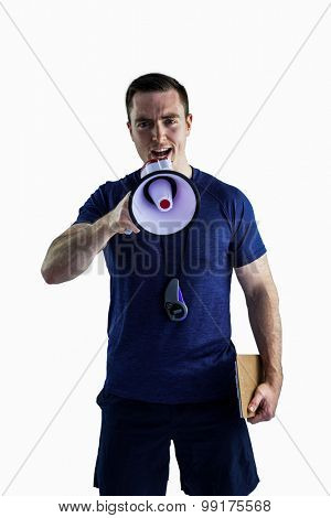 Portrait of a male trainer yelling through the megaphone
