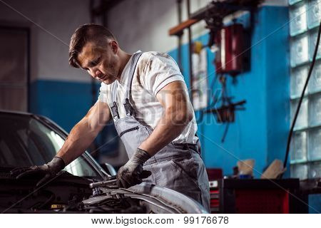 Uniformed Mechanic In Service Station