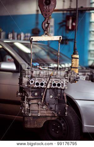 Engine Hanging On Automotive Crane