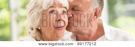 Man Is Kissing His Wife