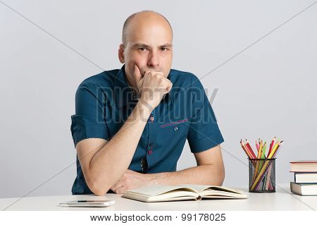 Serious Man On A Desk
