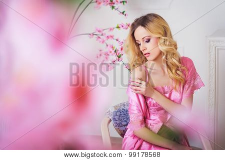 Blond Beautiful Woman In Pink Dressing Gown