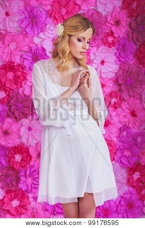 Blond Beautiful Woman In White Dressing Gown