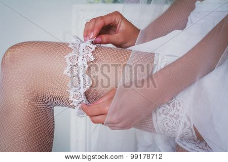 The Bride Holds The Garter In The Studio