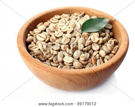 Green coffee beans with leaf in bowl isolated on white