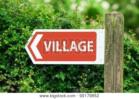 Direction Arrow, Sign To Village in Red Color