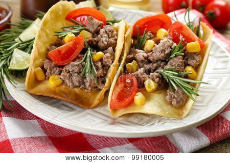 Mexican food Tacos in plate on napkin, closeup