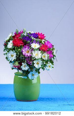 Autumn flower bouquet in vase