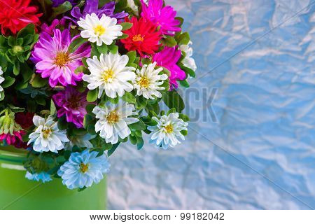 Flower bouquet on the crumpled paper background