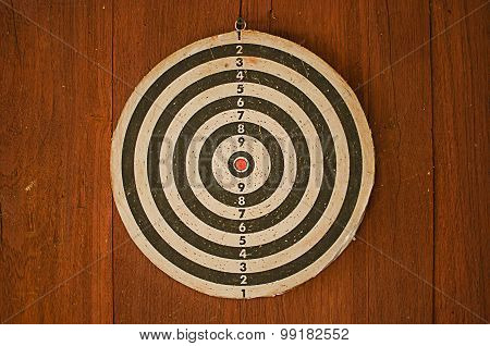 dart board on classical wood wall