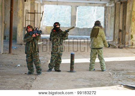 boys playing with gun during laser tag