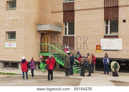 Tourists visit souvenir shop in Pyramiden, Norway.