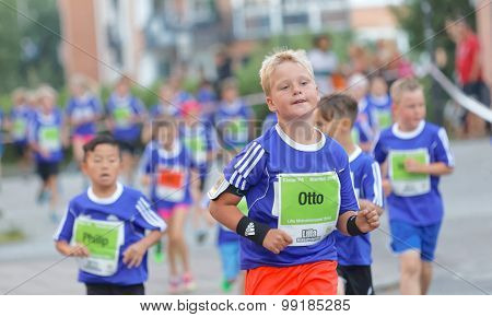 Young Blonde Boy Running