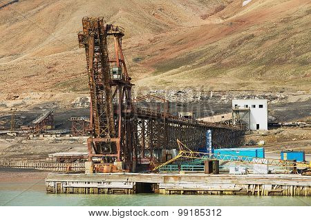 View to the pier of abandoned Russian arctic settlement Pyramiden, Norway.