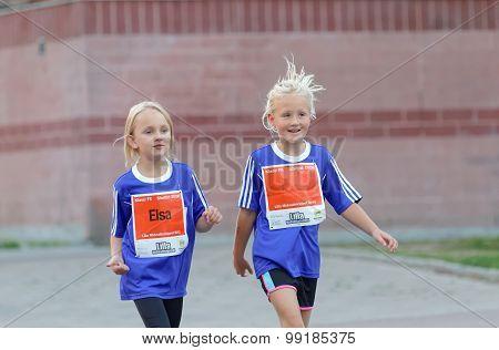 Two Smiling Girls Walking