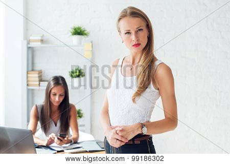 Portait of beautiful successful business woman looking confident and serious.