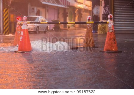 Orange Cones Around Overflowing Manhole