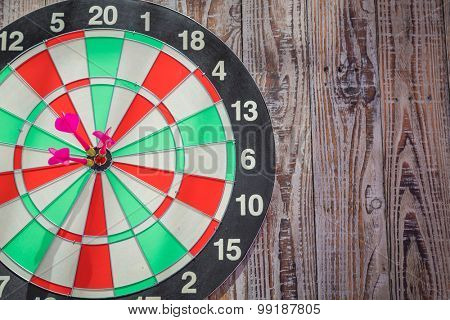 Dartboard on wood wall (Darts Hit Target)
