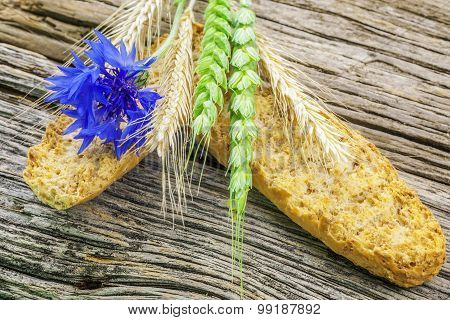 Toasts with with cereal and cornflower on wood