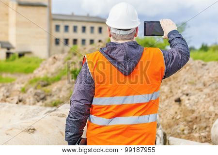 Construction Engineer filmed on cell phone