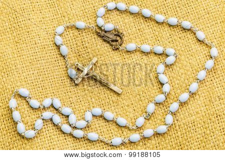 Rosary on jute fabric