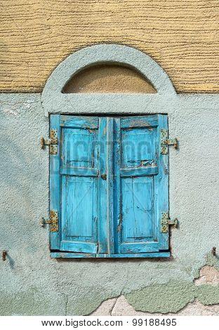 Closed old light blue window shutter