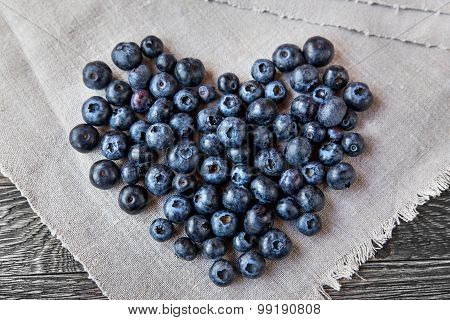 Blueberry Heart  Lie On A Homespun Tablecloth On Wooden Background. Rustic Cozy Background