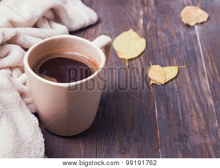 Coffee, Leaves And Blanket On The Wooden Background