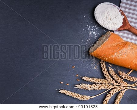 Bread, Flour And Wheat Ears On The Black Board