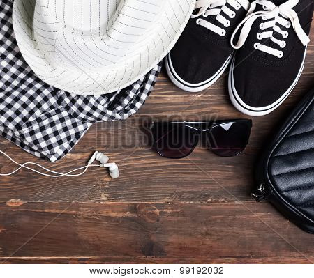 Modern Girl Outfit On The Wooden Background, Top View.