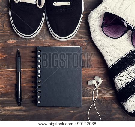 Modern Young Girl Outfit On The Wooden Background.