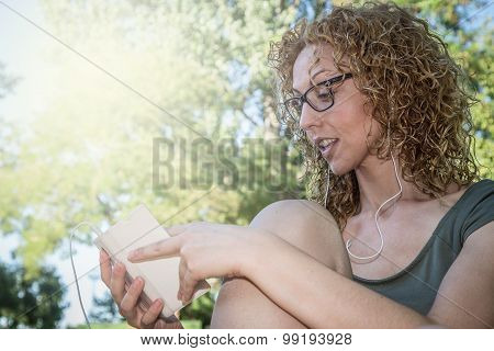 Attractive Blond Girl Listening To Music