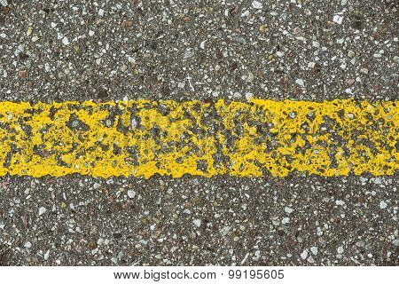 Detail of asphalt road with yellow  line