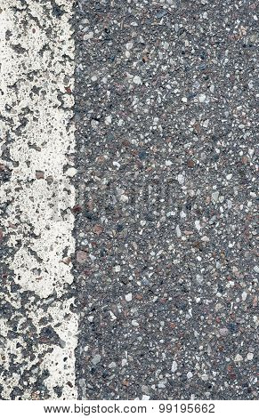 Detail of asphalt road with white line