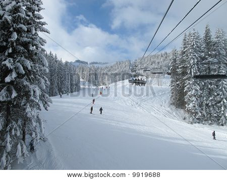 Ski Piste And Chair Lift With Snow Covered Trees