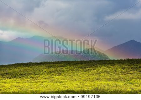 Rainbow above mountains, Alaska