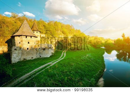 Ancient  stone castle  near the river. Sunset time