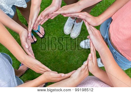 Many Arms Of Children With Hands Making Circle