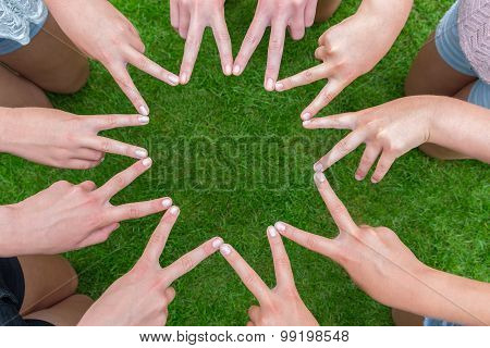 Many Arms Of Children With Hands Making Star