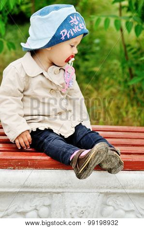 Sweet Toddler On The Bench