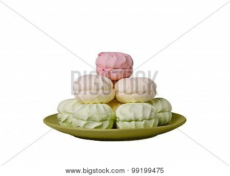Green, Pink, Marshmallow Cream Folded Into A Pyramid In The Gree