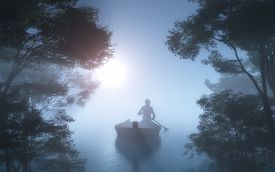 stock photo of boat  - Silhouette of a man in a boat in the fog - JPG